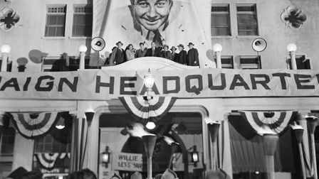 Broderick Crawford (1910 - 1986) addresses the crowd from the balcony of his campaign headquarters i