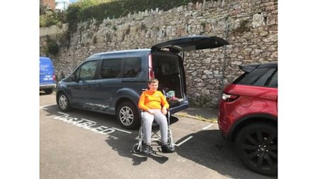 Disabled young man in parkin bay