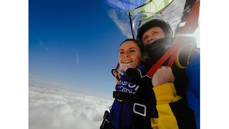 Young woman and trainer on Skydive