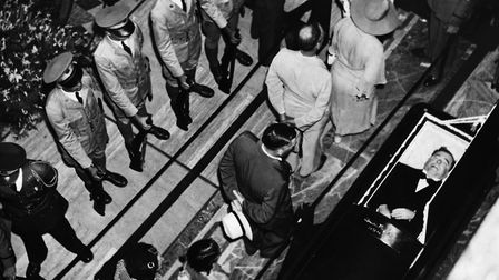 Mourners pass the open coffin of Huey Long after his assassination, 1935. (Photo by Hulton-Deutsch C