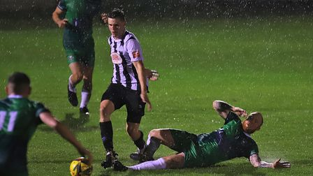 Chris Griffin advances through the rain for Colney Heath at Aylesbury United in the Southern League.