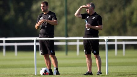 Norwich City Sporting Director Stuart Webber and Neil Adams watch on during the Pre-season friendly