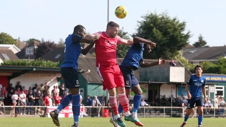 Sam Higgins of Hornchurch rises with Moses Carvalho of Walthamstow during Hornchurch vs Walthamstow,