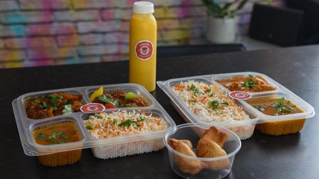 Some of the bento boxes, samosas and a mango lassi yoghurt drink at Waaghoba takeaway in Colman Road in Norwich.
