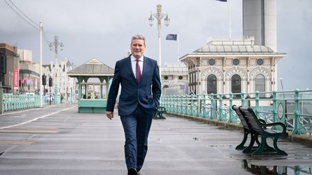 Labour leader Sir Keir Starmer walks along Brighton seafront promenade during the Labour Party confe
