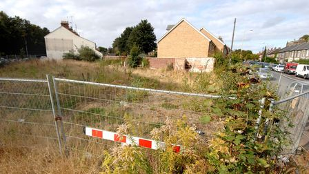 The overgrown site of the demolished Earl of Leicester pub, at the junction of Bowthorpe Road and De