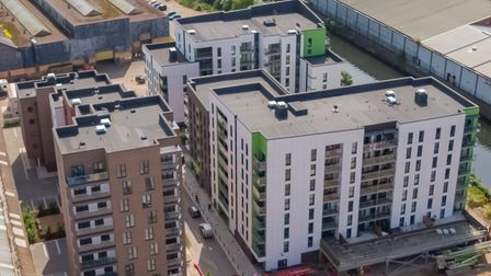 Aerial images of Phases 1, 2 and 3 of Canary Quay, a riverside residential development in Norwich bu
