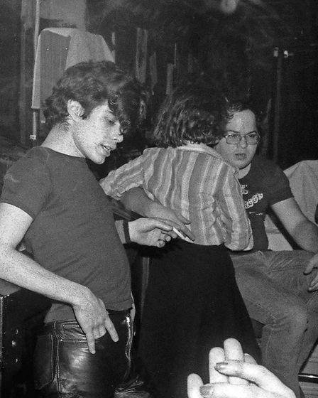 Georgie Day, drummer with The Miamis (left), at CBGB's legendary jukebox. Photo: Gary Green