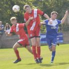 Charlie Parker heading the ball away