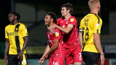 Milton Keynes Dons' Jay Bird celebrates scoring their side's first goal of the game during the Papa