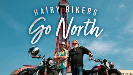 The Hairy Bikers stand in front of black pool tower with their motorbikes