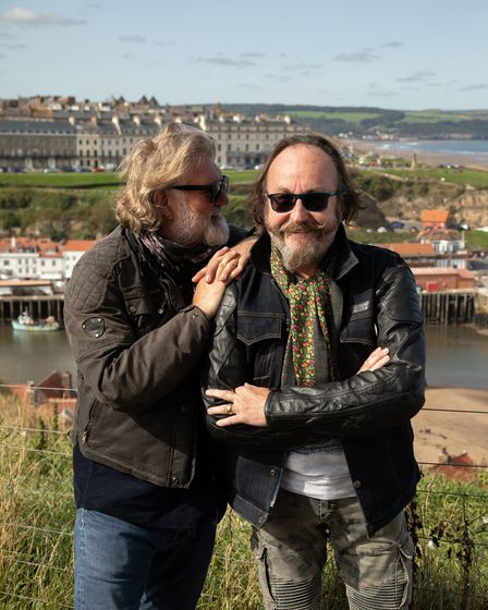 The Hairy Bikers stand with each other with Whitby in the background
