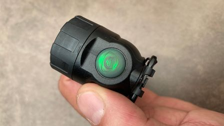 Close up of the on/off button light on the Streamlight Polytac 90X
