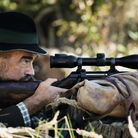 A man shooting a hunting rifle mounted with the Swarovski Z8i rifle scope