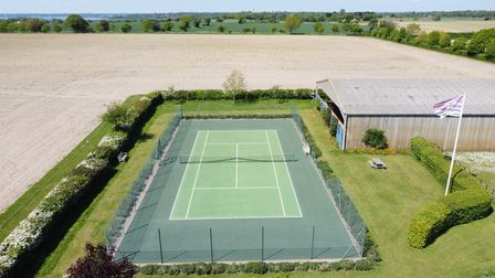 The hard court tennis court has recently been refurbished