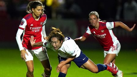 Arsenal's Tobin Heath (left) and Tottenham Hotspur's Jiali Tang battle for the ball during the Vital
