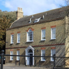Former male model Jesse Burgess has bought the Old Grammar School site in St Ives.