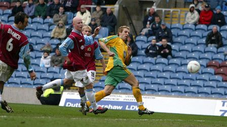 Burnley v Norwich City Norwich player Darren Huckerby scores the fifth goal against Burnley at Tu