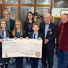 Principal Jane Bennett, with staff and students of Flegg High Ormiston Venture Academy students, receiving a cheque.