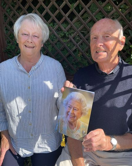 John and Jacqui Crouch receiving a letter from the Queen for their diamond anniversary