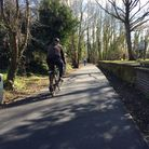 A cyclist on the upgraded section of Norwich's Marriott's Way between Gunton Lane and Hellesdon Road