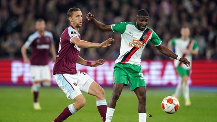West Ham United's Tomas Soucek (left) and Rapid Vienna's Kevin Arase battle for the ball during the