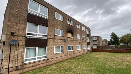 The window has now been boarded up after a fire broke out across two flats at Magnolia Green, Gorleston.