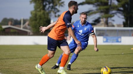 Lowestoft Town'sRyan Jarvis and Stratford Town player William Grocott.
