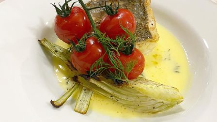 Pan-fried hake served with roasted fennel, dill beurreblancand cherry tomatoes