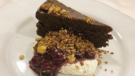 Chocolate nemesis,with vanilla cream and berry compote