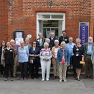 Saffron Walden Museum volunteers in a row outside the building