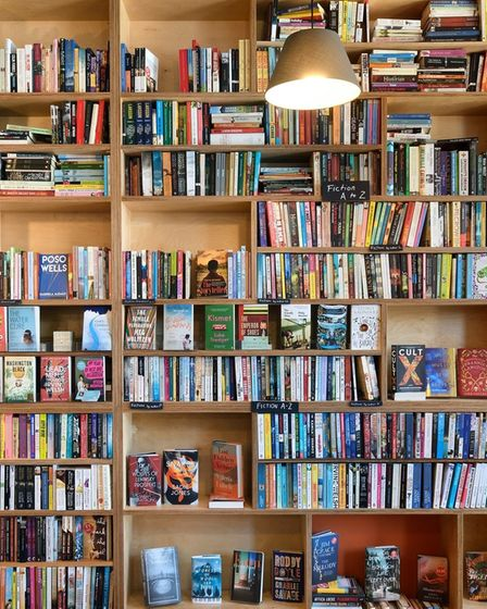 Every book lovers dream, a mildly chaotic floor to ceiling bookshelf filled with exciting books