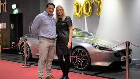 Customers were able to take photos with an Aston Martin at the premiere of the new James Bond movie