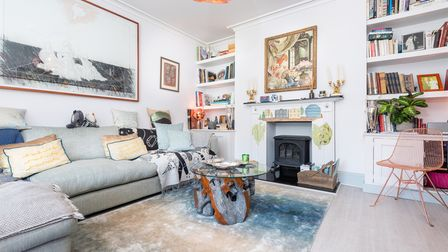 Light and airy living room with fireplace in this 5-bed home for sale on St Stephens Road, Norwich