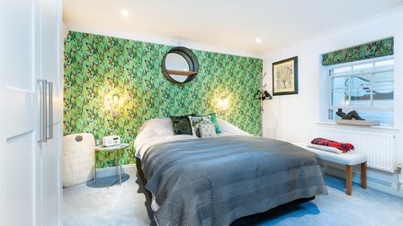 Bright colourful bedroom in this 5-bed townhouse for sale on St Stephens Road, Norwich