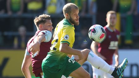 James Tarkowski of Burnley and Teemu Pukki of Norwich in action during the Premier League match at T