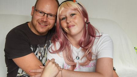 Paige Giles, 37, who is recovering from breast cancer at her home in Ipswich, with her partner Chris