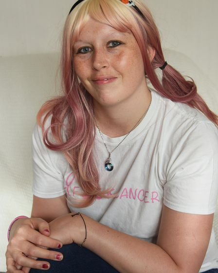 Paige Giles, 37, who is recovering from breast cancer at her home in Ipswich. Picture: DENISE BRADLE