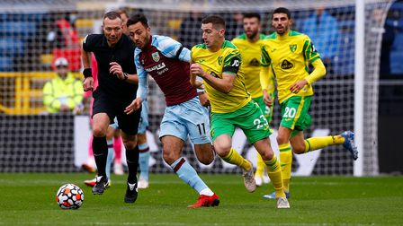 Dwight McNeil of Burnley and Kenny McLean of Norwich in action during the Premier League match at Tu