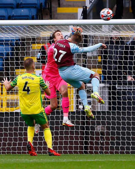 Tim Krul of Norwich punches clear and takes out Matej Vydra of Burnley during the Premier League mat