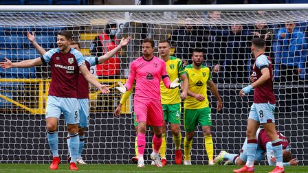 The Burnley players appeal to Referee Kevin Friend after Tim Krul of Norwich punches clear and takes