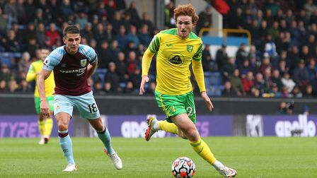 Ashley Westwood of Burnley and Josh Sargent of Norwich in action during the Premier League match at