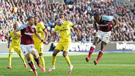West Ham United's Michail Antonio heads at goal and misses during the Premier League match at the Lo
