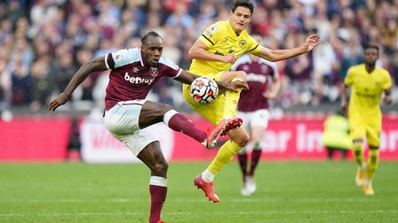 West Ham United's Michail Antonio (left) and Brentford's Christian Norgaard battle for the ball duri