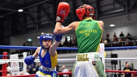 Jed Baker, left, boxes William Bell in the final