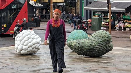 Artist Veronica Ryan and her Windrush sculptures in Narroway Square by St Augustin's Tower.