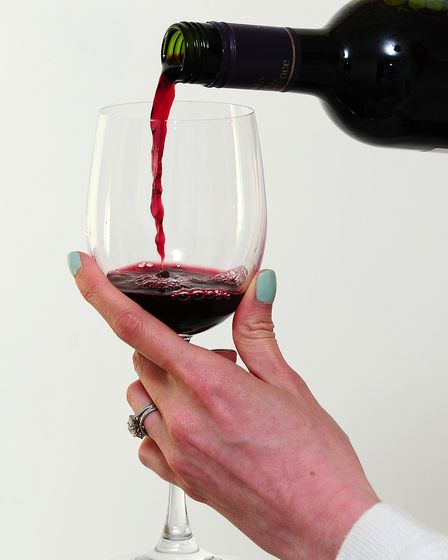 File photo dated 22/04/14 of a person pouring a glass of wine, as a decline in drinking among middle