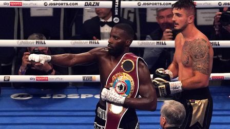 Lawrence Okolie (left) celebrates after retaining the WBO World Cruiserweight title belt after defea