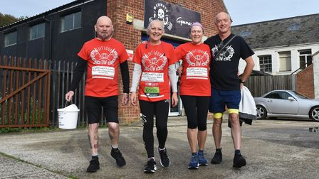 Caroline Gosling and Andy Elvin with Sue and Terry Willgoss at the start of the virtual London Marathon outside Mammoth Gym