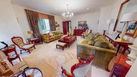 One of the excellent-sized reception rooms at Carramore, York Drive, Bowdon